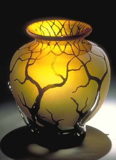 "Bellied Root Vessel by Bernard Katz  Hand blown glass vase shown in  Gold Topaz. Hand etched and sandblasted tree branches in black.  Clear glass blown branches at the base of the vessel.  Actual Size: 11""H x 8""W  #glass #vase #artglass"