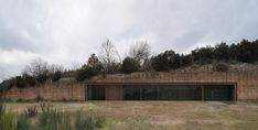house in the rock by romano adolini emerges from abandoned quarry bluff