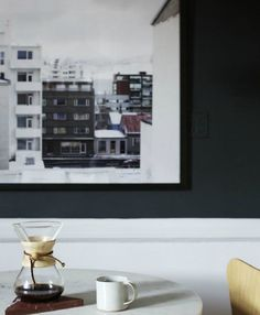 Large-scale prints of landscapes and cityscapes can feel like windows and open up a small room