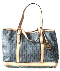 f81fffb0d462a Gently used Michael Kors Denim Printed with Leather Trim Bag for sale at  Secret Stash - Pakistan s top shopping site for designer bags at a discount.