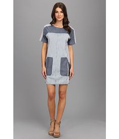Rebecca Taylor Railroad Dress Stripe Combo - SKU 8297276. Get on track to exceptional style with the Rebecca Taylor® Railroad Dress! A charming shift dress fabricated from a stretch cotton denim with a vintage-inspired patchwork and pinstripe design. Round neckline. Short sleeves. Exposed back-zip closure. Porkchop hand pockets with zipper detailing. Straight hem with scalloped side seams.