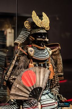 Nuinobedō Tōsei Gusoku Armor with war fan and gold paulownia leaf crest, 16th century CE Japan. This armor was a gift to Kobayakawa Takakage 小早川 隆景 (1533 - 1597), a member of the Mōri family, from the great general Toyotomi Hideyoshi 豊臣秀吉, one of the generals credited with the unification of Japan. (Photo: Patricio Trillo). -The Ann & Gabriel Barbier-Mueller Museum-