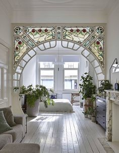 stained glass arch in interior designer anouk Taeymans' Art Nouveau apartmen. - Inspirational Interior Design Ideas for Living Room Design, Bedroom Design, Kitchen Design and the entire home. Foyer Design, Deco Design, Design Case, Design Bedroom, Art Nouveau Design, Tile Design, Belle Epoque, I Like Lamp, My New Room