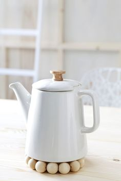 white teapot and light wood