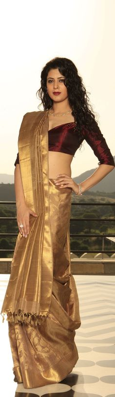 Note the color of the blouse. Recall your golden saree with this look