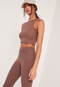 For off duty days and lazy nights, you need a basic crop top, right? This brown beaut is comfy AF, which is just what we girls need sometimes. In a ribbed style and cropped length, you gotta wear these with a retro teal skirt and perspex bo...
