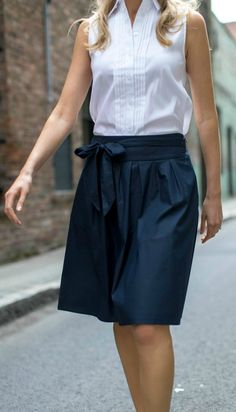 white sleeveless collared shirt with eyelet back shoulders, navy blue tie waist midi skirt, navy two strap slide sandals