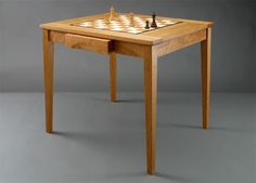 Handmade Custom Wood Chess Tables - This table, 31″ long by 26″ wide and 29″ high, is slightly smaller than the one described above. Made of beautiful cherry. Price: $1,750