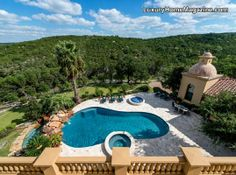 Extraordinary estate with breathtaking backyard! #pool #landscaping #design #trees #patio #views #balcony