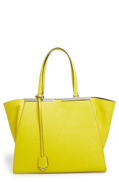Adding a pop of color with this neon Fendi shopper.