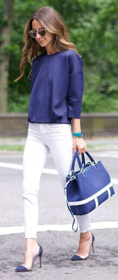 Shop this look on Lookastic: https://lookastic.com/women/looks/long-sleeve-blouse-skinny-jeans-pumps/19024   — Blue Long Sleeve Blouse  — Aquamarine Watch  — White Skinny Jeans  — Blue Leather Tote Bag  — Navy Suede Pumps