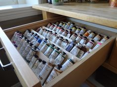 Inspired by drawer inserts used to store spice jars, I made my own out of scrap wood to store my oils and arranged them by color in my studio.  Two this size and another one for large tubes of paints and mediums.  I love this!  No more searching through a box!!  Every color at a glance.