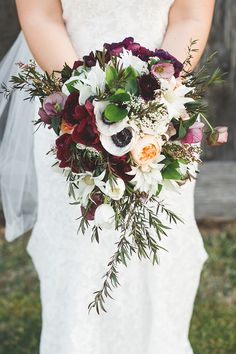 Textured burgundy, peach and white bridal bouquet for a rustic country wedding | Little Black Bow Photography | See more: http://theweddingplaybook.com/rustic-burgundy-country-wedding/
