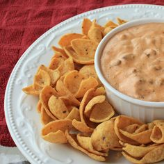 Chili Cream Cheese Dip ~ Cream Cheese, a can of chili without beans and a microwave and you have one quick, easy and delicious dip. I served it sprinkled with shredded cheddar cheese, chopped green onions and tomatoes. I served tortilla chips with it. Everyone asked for the recipe.