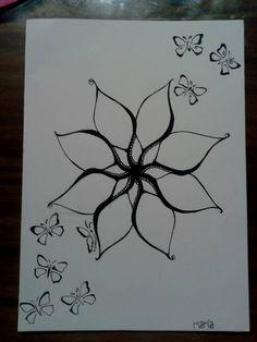 Flor y mariposas hecho con microfibra.