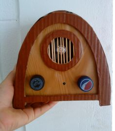 Hello! This was a radio that I did for my daughter play Video running radio: http://www.youtube.com/user/PeckGenGibre?feature=mhum#p/a/u/0/fH7RgwhX8xQ The radio was made with old cardboard box, bottle caps, hot glue and some electronic components salvaged from broken appliances. But they are easily found in electronics stores. Works as follows: By pressing the right button, turn on the radio, turning on a light in the center and emitted a sound tha...