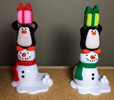 Polymer clay snowman, penguin, and present statues (created by Kelly Bouchard)