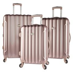 Available in a sleek pink, gold, or silver, this stylish Kensie 3 piece expandable hardside luggage set provides plenty of storage for your next adventure. With three interior pockets per spinner, the
