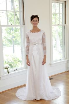 The Selena Modest Wedding dress with long lace sleeves. Epoch Collection