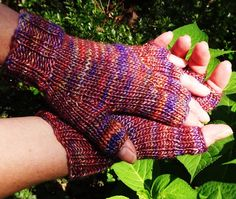 Half finger ladies gloves are handknit in multicolored, variegated 51% silk and…