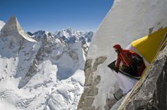 Photo by Jimmy Chin:  Room with a View - Renan Ozturk taking in the Garwhal Himalaya during an attempt on Mount Meru.By purchasing this print, you are helping provide relief to Sherpa families in crisis, as well as long-term support that transcends tragedy. One-hundred percent of Sherpa Photo Fund profits go to the Sherpa community via the nonprofit Alex Lowe Charitable Foundation, which has been working with Sherpa climbers in the Khumbu since 2003. For more information about t...