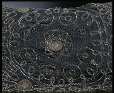 Evening dress | Coco Chanel Date:1922 (made)  Artist/Maker:Chanel, born 1883 - died 1971 (designer)   Kitmir (embroiderer)  Materials and Techniques:Hand-sewn silk georgette, hand-embroidered with glass beads and gold thread. Detail