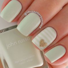 "I'm seriously obsessed with these amazing @johnrussobeauty colors! This pale mint green is @johnrussobeauty ""Bushey"" and is the most flattering green I have! Look how tan it makes me look! Accent nail inspired by @amkuch15 ✨"