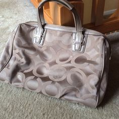 Authentic Coach Handbag - Light Brown Authentic Coach Handbag - Light Brown - Still in good condition. A few minor marks - nothing too noticable. Absolutely loved this bag. Dimensions approx 11.5x10in Coach Bags