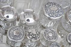 feminine silver-topped vanity jars