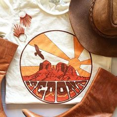 My new favorite tee☀️ Snag a #Sedona tee in graphic tees link-> Perfectly paired with our burnt orange fringe earrings.  #desertlife #gypsylife #electricwest #thewhiskeyvixen