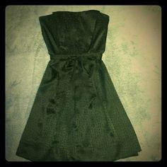 White House Black Market Strapless Dress Black silk strapless White House Black Market dress, size 4, has a black dot pattern. Worn only once to a wedding. White House Black Market Dresses Strapless