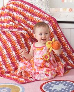 Bright bold stripes get textural with an added stitch detail. Shown in Bernat Baby Coordinates.