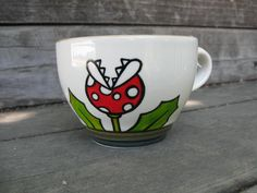 Piranha Plant Mug - Super Mario Inspired. $17.00, via Etsy. Perfect for my Red Bull or coffee in the morning :)