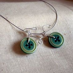 DIY Inspiration: Wire Button Bike Pendant from Sweet Little Somethings Facebook page here. Before posting this I went to her FB photos and Etsy store (which is empty) to try and find this with no luck.   For wire work tutorials and DIYs go here: truebluemeandyou.tumblr.com/tagged/wire