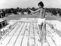 Jerry Shotkoski, 14, catches a glimpse of photographer Ed Rath just as he left the high diving platform at Hitchcock pool in August 1976. ED RATH/THE WORLD-HERALD