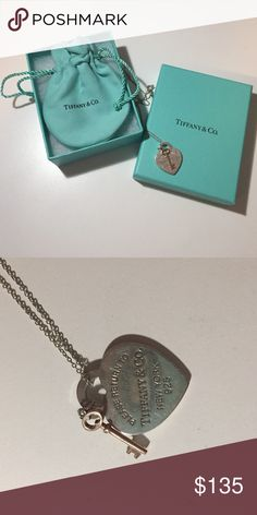 Tiffany & Co. Heart w/ key Necklace Authentic Tiffany and Co.                                            18 inch chain                                                            Lightly worn, with minor surface scratches.    Comes with Tiffany & Co. box, pouch, and ribbon Tiffany & Co. Jewelry Necklaces