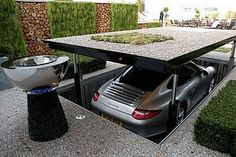 Garage!   * you notice the car being stowed is a Porche.   Have to have that kind of money to get the thing.