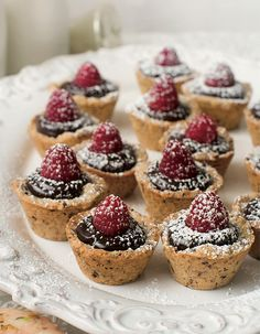 A hazelnut shortbread forms the base of these tartlets, which are filled with raspberries and chocolate ganache.