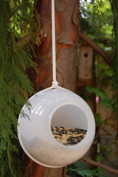 make a recycled lamp globe birdfeeder for pocket change! Thanks to The Art of Doing Stuff :)