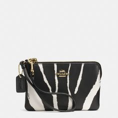 Crafted in exotic zebra-embossed leather, this bold wristlet has built-in card slots to keep essentials secure. The iconic dogleash strap allows you to wear it on the wrist or clip it into a day bag. Coach Handbags, Coach Purses, Purses And Handbags, Coach Bags, Handbag Accessories, Fashion Accessories, Coach Tennis Shoes, Carry All Bag, Look Here
