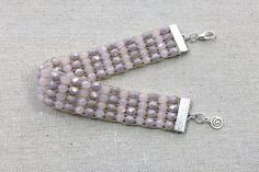 How to use a bead loom to make a crystal bead bracelet including loom weaving terms and how to set up and use your bead loom.