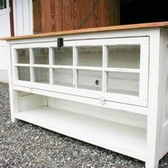 My dad and I build furniture from antique salvaged items. We build furniture with all kinds of things from old doors, windows, salvaged wood, and repurposed furniture pieces. We built the sides and back of this TV console from an old door. The front is a