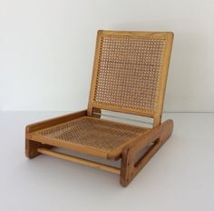 Beautifully weathered wood and cane canoe chair. In good vintage condition, still sturdy and ready for years of use at the campsite or