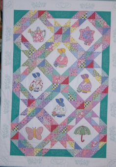 Sunbonnet Sue quilt shows many types of designs and materials mixed into the Sunbonnet Sue motif. Quilt Baby, Baby Quilt Patterns, Applique Patterns, Applique Quilts, Sunbonnet Sue, Quilting Projects, Quilting Designs, Kit Bebe, Quilt Border