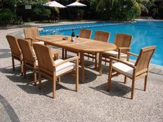 "New 9 Pc Luxurious Grade-A Teak Dining Set - 94"" Oval Table And 8 Stacking Arm Chairs [Model:WV5] by WholesaleTeak. $1649.99. The chairs are stackable for easy storage.. ADD SUNBRELLA FABRIC CUSHIONS BY SEARCHING ""Wholesaleteak Dining Cushion"" ON AMAZON, CUSTOM MADE FOR THESE STYLE CHAIRS. You can lengthen the table with minimal effort by simply opening the butterfly leaf extensions.. Table Dimension: 71"" L (without extension) and 94"" L (with extension), 40"" W ..."