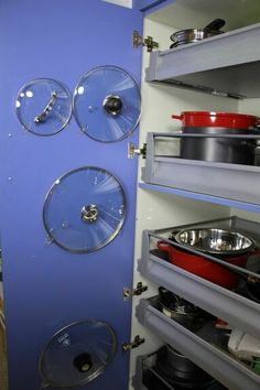 31 Storage Hacks That Will Instantly Declutter Your Kitchen s 31 storage hacks that will instantly declutter your kitchen, Store your pot lids inside a cabinet - Small Kitchen Ideas Storages Pot Lid Organization, Pot Storage, Lid Organizer, Kitchen Drawer Organization, Spice Storage, Storage Canisters, Storage Hacks, Kitchen Storage, Organizing