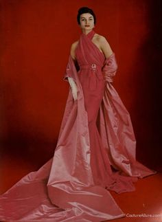 Pierre Balmain. Deep pink silk evening gown from 1957 with a long train, accented with a huge pink silk taffeta stole.
