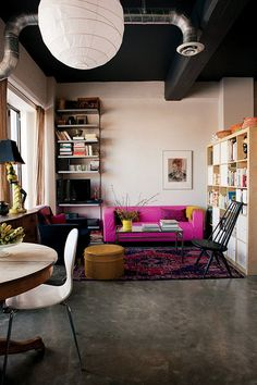 magenta sofa in living room with paper lantern by the style files, via Flickr. #livingRoom #homeDecor