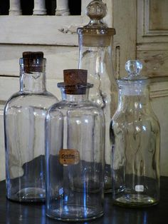 Set of four French glass bottles from a Pharmacy apothecary vintage