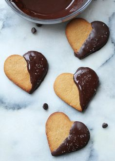 Valentine's Day is almost here. We think these would be the perfect way to celebrate! Chocolate-Dipped Peanut Butter Hearts - The City Sage Köstliche Desserts, Delicious Desserts, Dessert Recipes, Yummy Food, Chocolate Peanut Butter Cookies, Chocolate Dipped, Eat Dessert First, Dessert Bars, Menu Saint Valentin